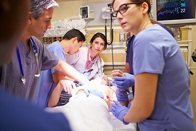 Clinicians caring for a patient in an emergency room