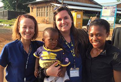 Sara, a Ugandan midwife, dressed her son in a U-M t-shirt.