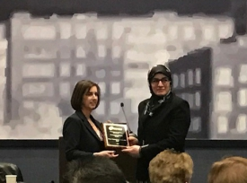 DNP student Leila Cherara accepted the award on Dr. Tschannen's behalf