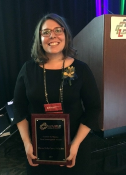 Dr. Costa with her Harriet H. Werley New Investigator Award