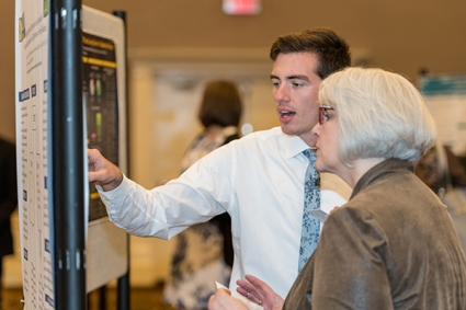 Fauer discusses his research at Dean's Research Day