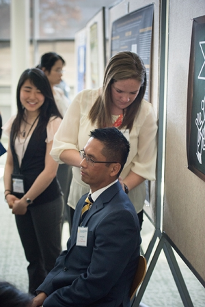 Haupt, at 2015 Dean's Research Day, conducted testing for sensitivity to pressure-induced pain. Dr. Jessie Casida was a willing test subject