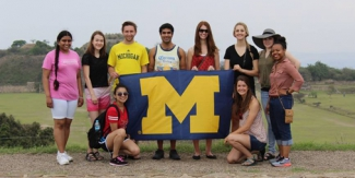 Nursing and LSA students display the M flag at Monte Alban