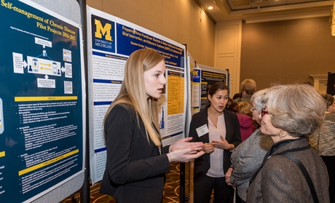 Dr. Pohl (right) speaks to student Katie Burmester about her work.