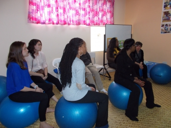 Students learn about the birthing balls frequently used during labor and delivery