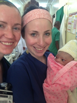 Midwifery students and one of their special deliveries