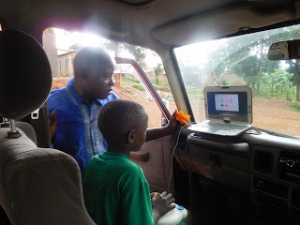 Uganda: A trainer administers Computerized Cognitive Rehabilitation Therapy.