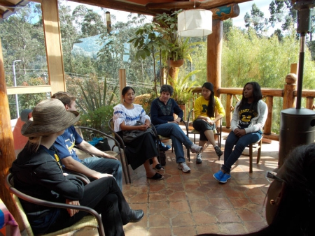 Eagle and students listen to an Ecuadorian midwife