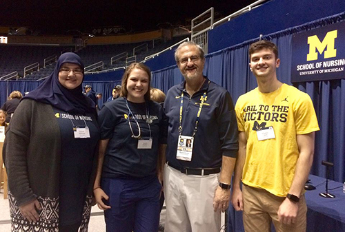 Students with Pres. Schlissel at tailgate
