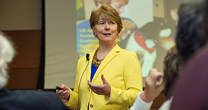 U-M School of Nursing Dean Patricia D. Hurn talks to attendees of the 2018 Homecoming festivities
