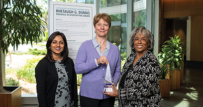 U-M School of Nursing Dean Patricia D. Hurn poses with colleagues Rushika Patel and Patricia Coleman-Burns in the School of Nursing building with the Reaugh Dumas Diversity Award