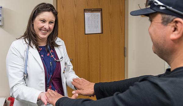 Nurse examines patient