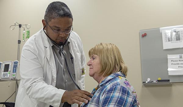 Student practices examination with volunteer patient