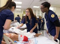 Students using skills lab during trauma exercise