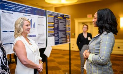 Sherri Fannon, winner of the Alumni/Faculty category chats with Jessica Fladger, winner of the Medvec Innovation award