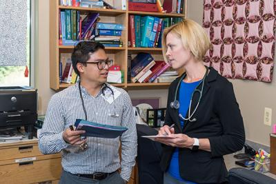 Gultekin consults with Jose Galianto, a UMSN alum who also cares for patients at Hope Clinic