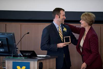 Dean Patricia Hurn presented Friese with a professorship medal