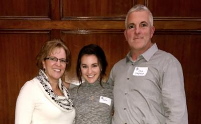 Katie and her parents at an ovarian cancer awareness fundraiser