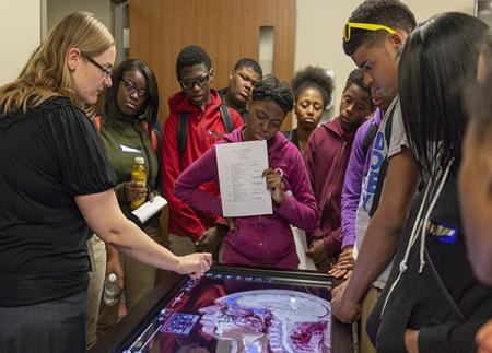 Students learning about the Anatomage table, one of the many high-tech learning tools in UMSN's CLC