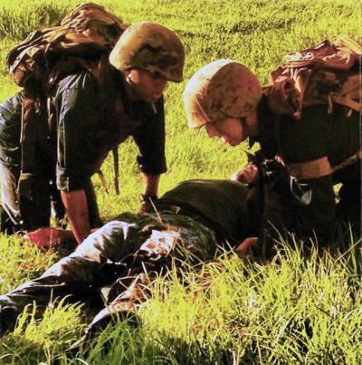 DeLong (right) during an exercise as part of a Tactical Combat Casualty course