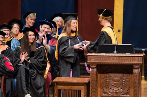 Dean Hurn presented Leech with UMSN's Teacher of the Year award at commencement